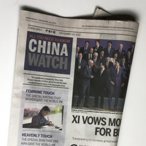 """Folded newspaper section """"China Watch"""""""