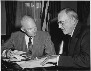 President Dwight D. Eisenhower meeting with Secretary of State John Foster Dulles at the White House.