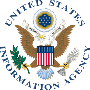 USIA seal with bald eagle in the center and an American flag