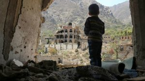 Child gazing a rubble