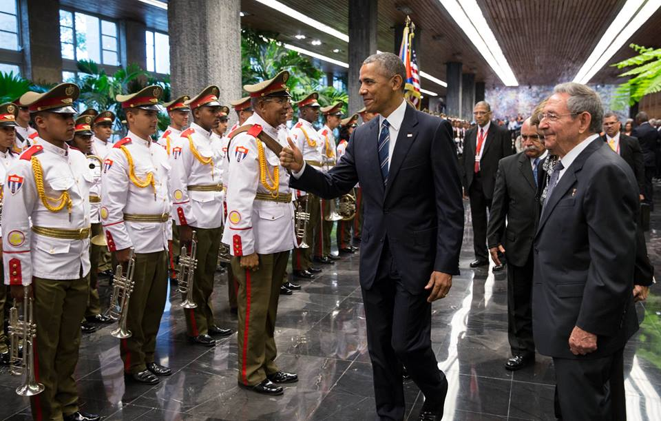 Obama and Castro greeted by Cuban military officers