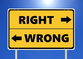 "Road sign displaying arrows labled ""Right"" and ""Wrong"""