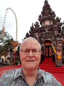 head shot of Mike Anderson with Indonesian temple in background