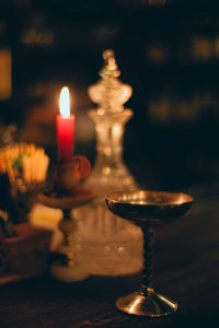candles and vessels with dark background
