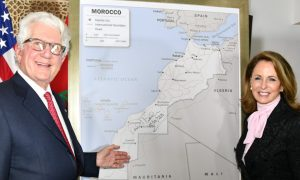 Ambassador Fischer points at a map of the Western Sahara.