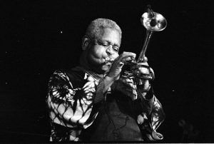 Trumpeter Dizzy Gillespie blowing his horn