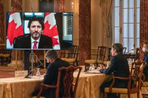 Photo of Secretary Blinken and PM Trudeau on a large screen