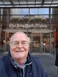 Mike Anderson in front of entrance to New York Times