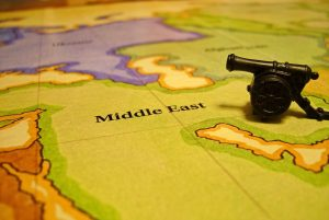 Middle East map with toy cannon
